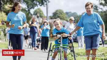 Double marathon boy raises more than £137000 - BBC News