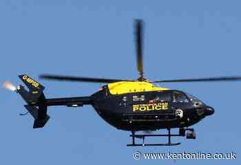 Police helicopter in search for suspect over village