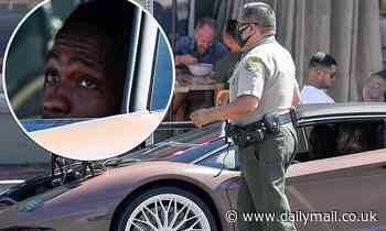 Travis Scott gets pulled over in his Lamborghini Aventador in WeHo... after debuting Cactus Jack PPE - Daily Mail