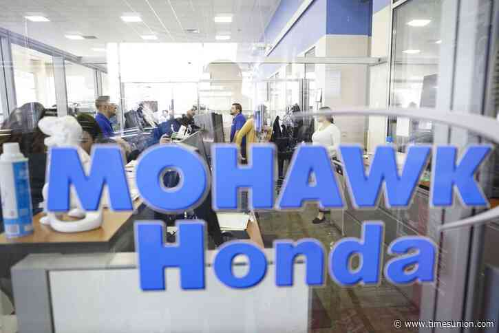 Mohawk Honda leading toy and book drive