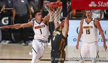 Porter, Jokic lead Nuggets past Thunder, 121-113 in OT