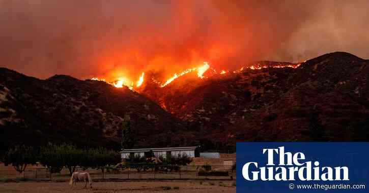 California: thousands under evacuation order as fire rages east of Los Angeles - The Guardian