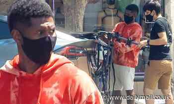 Usher goes casual in orange tie-dye as he buys bike mount in West Hollywood during quarantine break