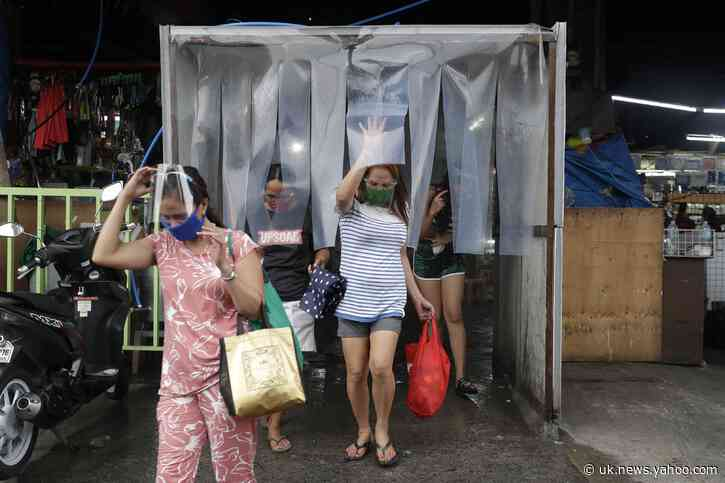 Asia Today: Manila back under lockdown as virus cases surge