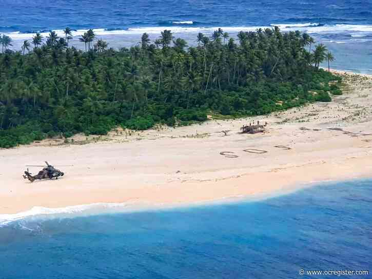 3 rescued from Pacific island after writing SOS in sand