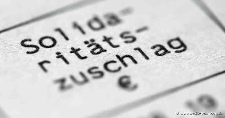Dürr: FDP klagt im September in Karlsruhe gegen Soli