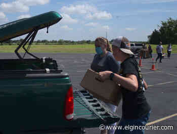 Church hosts drive-through produce distribution - Elgin Courier
