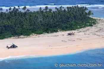 Homens pedem socorro por meio de SOS na areia em ilha do Pacífico - GauchaZH