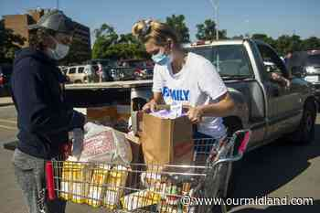 Photos: Mobile food pantry assists hundreds at Midland High School - Midland Daily News