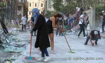 Com luvas, máscaras e vassouras, população de Beirute se mobiliza para limpar destroços da explosão - Jornal O Globo