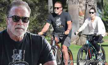 Arnold Schwarzenegger gets out for some exercise as he goes for a bike ride with daughter Christina