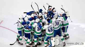 Tanev's snipe 11 seconds into OT sends Canucks past Wild to seal qualifier series