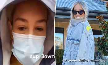 Phoebe Burgess wears face mask walking in rain in Bowral - Daily Mail