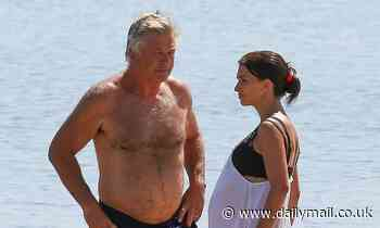 Pregnant Hilaria Baldwin, 36, relaxes on the beach with husband Alec, 62, in the Hamptons