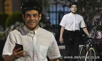 Rami Malek looks as he enjoys a bike ride through London at night