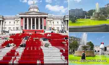 Extinction Rebellion protesters pour fake blood on steps at Trafalgar Square