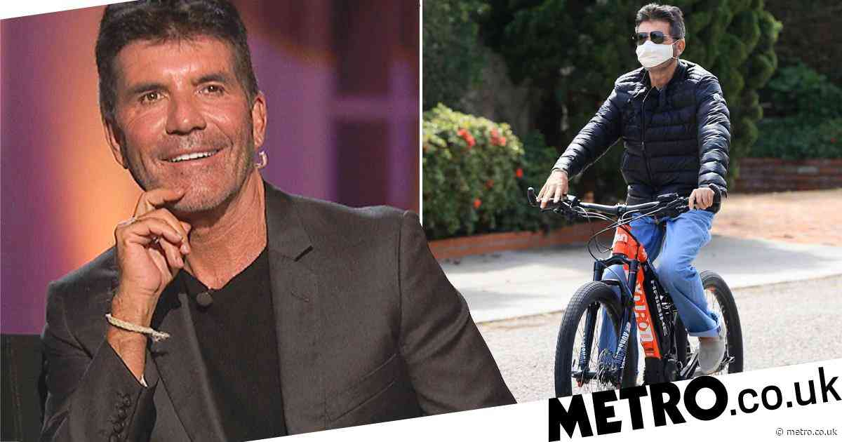 Simon Cowell is 'recovering from 5-hour surgery' after 'breaking his back' in bike accident