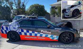 Queensland duo allegedly steal car from dealership before slamming into two NSW Police cars