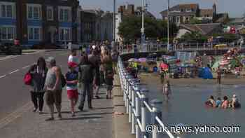 Britons flock to Weymouth beach as UK set for record-breaking heatwave - Yahoo News UK