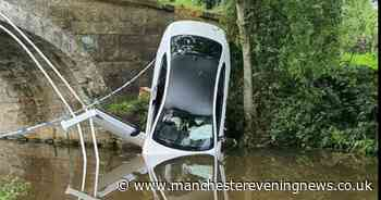 Brand new £50,000 BMW plunges into canal after M6 pursuit