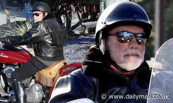 Arnold Schwarzenegger rides his motorcycle around town after welcoming his first grandchild