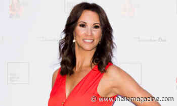 Andrea McLean floors fans in a plunging red dress from Oliver Bonas