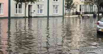 Flash flooding leaves town underwater as heatwave triggers heavy thunderstorms