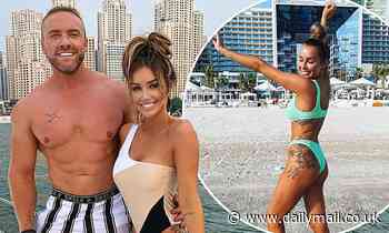 Love Island's Laura Anderson wows in swimsuit as she poses with shirtless beau Tom Brazier in Dubai