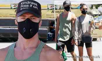 Derek Hough wears a 'kindness pass it on' cap as he takes girlfriend Hayley Erbert to market