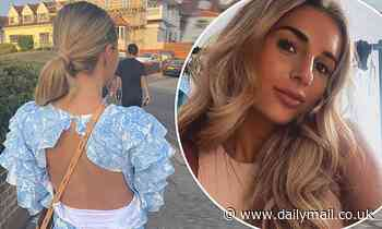 Pregnant Dani Dyer struggles to zip up clothes in photo