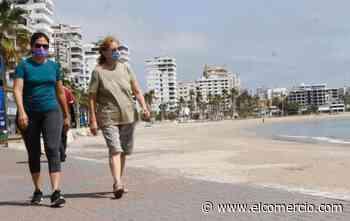 El feriado de agosto empuja la reactivación de negocios en Salinas, cuyas playas permanecen cerradas - El Comercio (Ecuador)