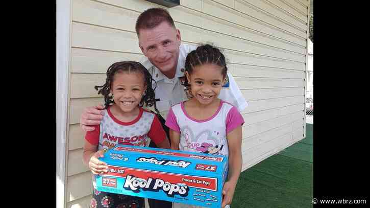 Kids surprise police officer with ice pop on hot summer day