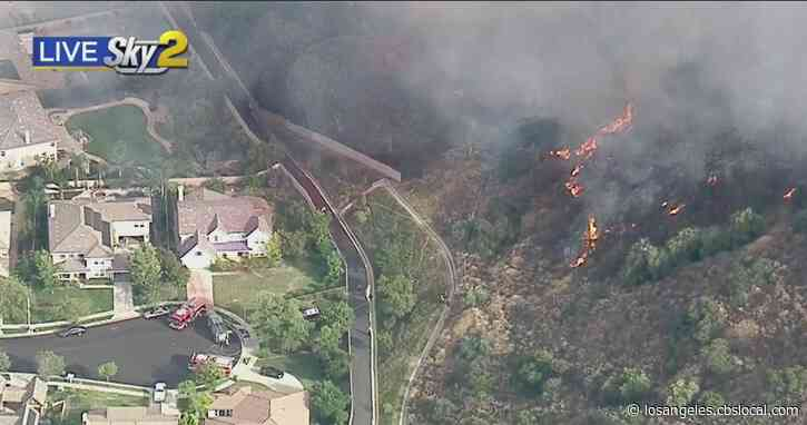 Corona FD Battles Wildfire Near Skyline Drive Trail Burning Close To Homes