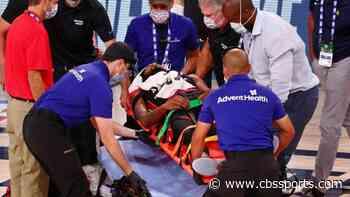 Heat's Derrick Jones Jr. taken off of floor on a stretcher after collision with Pacers' Goga Bitadze