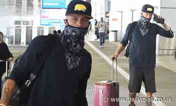 Jeremy Meeks dons a patterned face mask as he cuts a low-key figure while jetting intoMiami
