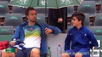 Nice guy Ernests Gulbis shares his umbrella with a ball boy - Eurosport.co.uk