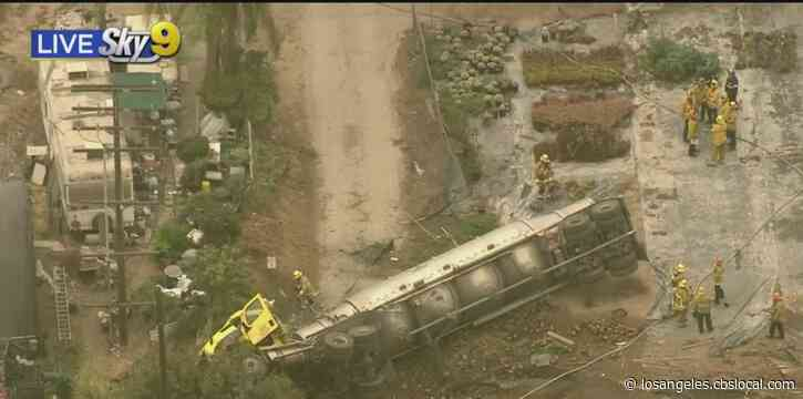 Big Rig Leaking Fluid After Rolling Down Embankment Off 110 Freeway In Harbor City