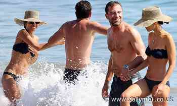 Jordana Brewster is a bikini bombshell as she holds hands with shirtless new beau Mason Morfit