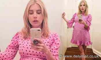 Pregnant Emma Roberts drapes bump in 50s chic polka dot outfit