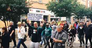 Protesters falsely claim coronavirus 'is a lie' and boo passersby wearing masks