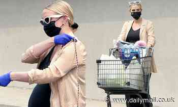 Ashlee Simpson cuts a cool figure and shows off her growing baby bump on a grocery run in LA