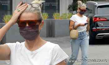 Cameron Diaz is the image of California cool as she runs errands in jeans and a tee shirt combo