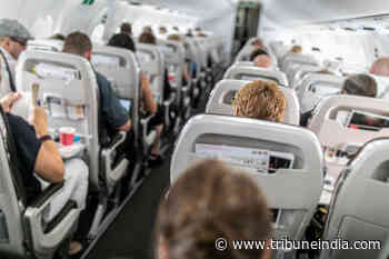 DGCA: Flyers can take photos, videos in flights but can't use recording gadgets leading to 'chaos' - The Tribune India