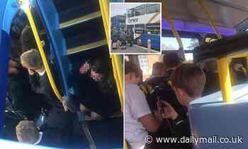 Angry parents hit out as children are crammed onto standing-room-only school buses