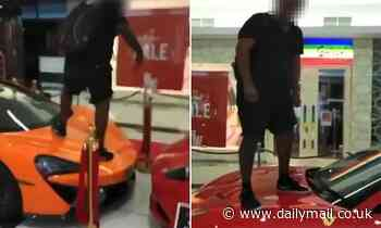 Shocking moment teenager jumps and spits on $500,000 McLaren and Ferrari Supercars