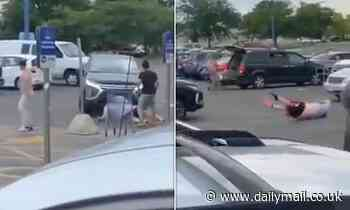 SUV driver accelerates towards two men and knocks them flying during vicious brawl in parking lot