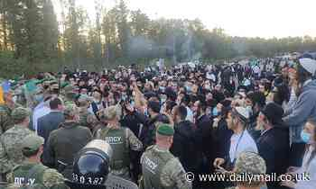 2,000 Hasidic Jews gather at Ukraine's border where they are barred entry from Belarus