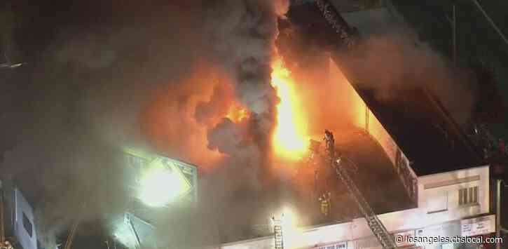 Large Flames Torch South LA Dry Cleaning Plant