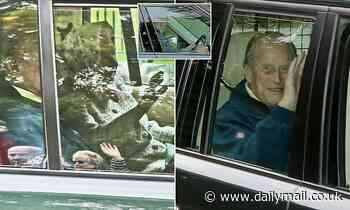 Waving goodbye to Scotland! Queen and Prince Philip are driven away from Balmoral