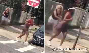 Crazed 'Karen' hurls a glass bottle at a black jogger and screams racist abuse